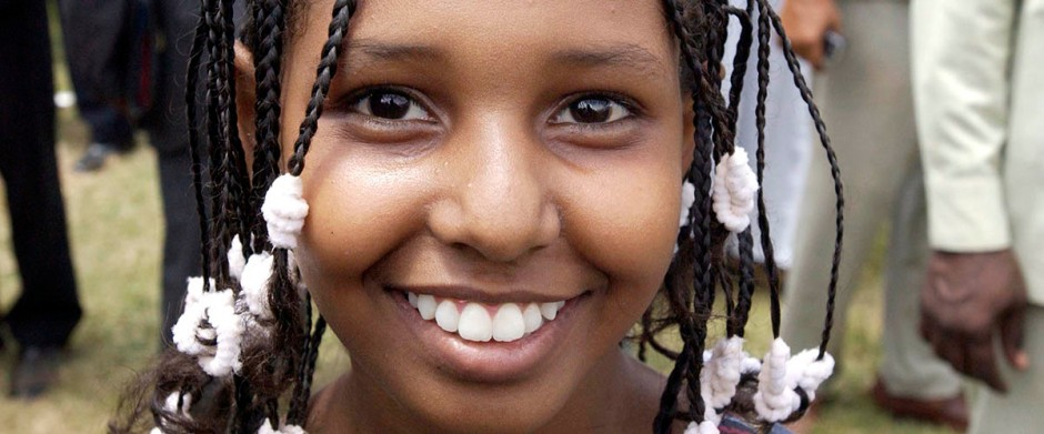 A Sudanese girl beams with happiness at the inauguration ceremony of the Transitional Government of National Unity of Sudan in Khartoum. (Photo: UN Photo/Evan Schneider)